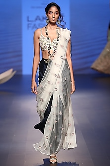 Stone embroidered choli with saree and navy palazzo pants by Payal Singhal