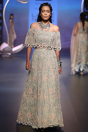 Off white embroidered top and lehenga skirt by Payal Singhal