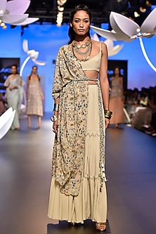 Stone embroidered sharara set with jacket and belt by Payal Singhal