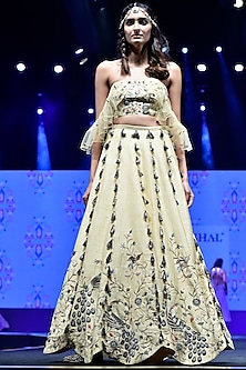Pale Yellow Embroidered Bustier With Ruffled Lehenga Skirt by Payal Singhal