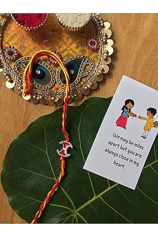 Red & Yellow Enameled Evil Eye Cotton Thread Rakhi by Rakhiwale
