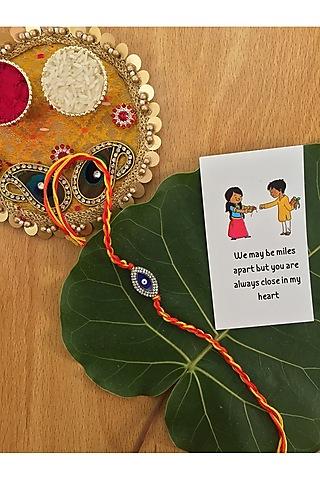 Red & Yellow Enameled Evil Eye Thread Rakhi by Rakhiwale