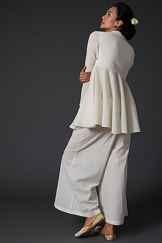 Ivory Embroidered Peplum Top by Balance by Rohit Bal