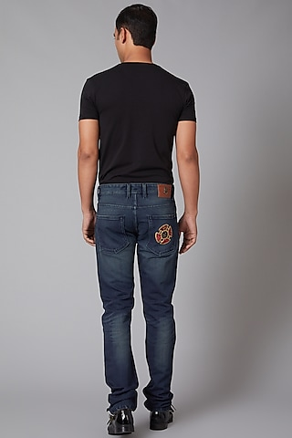 Cobalt Blue Tiger Embroidered Jeans by Rohit Bal Men