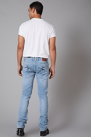 Sky Blue Eagle Embroidered Jeans by Rohit Bal Men