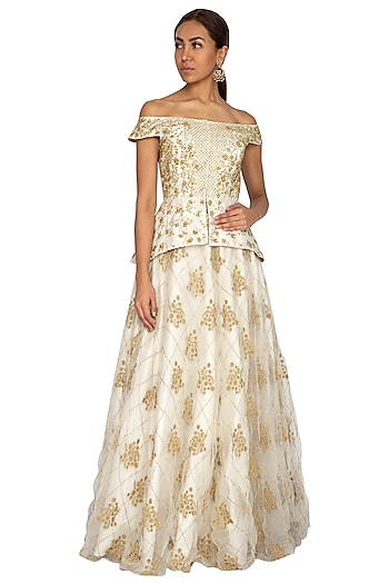 Ivory Embroidered Peplum Blouse With Skirt by Ridhi Arora