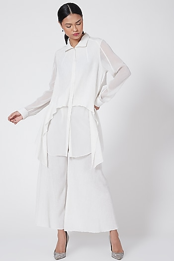 White Pinstriped Flared Trousers by Rohit Gandhi & Rahul Khanna