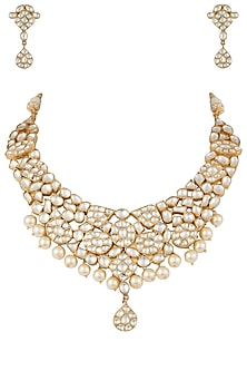 Gold plated white jadtar pearl necklace set by RIANA JEWELLERY