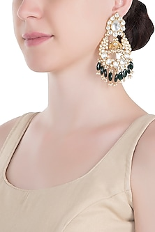 Gold plated green and white jhumka earrings by RIANA JEWELLERY