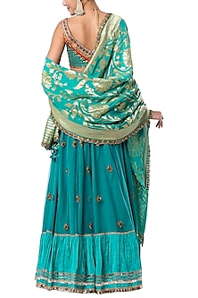 Turquoise embroidered lehenga set by ROCKY STAR
