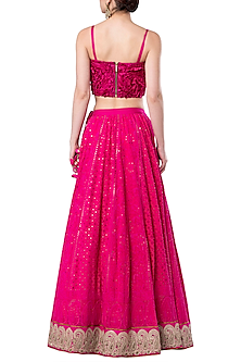 Hot pink embroidered crop top with lehenga skirt by ROCKY STAR