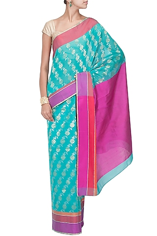 Turquoise flower handwoven sari by Rahul Mishra