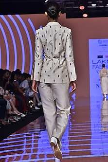 Ivory Ruffled Blazer With Pants & Belt by Ridhi Mehra