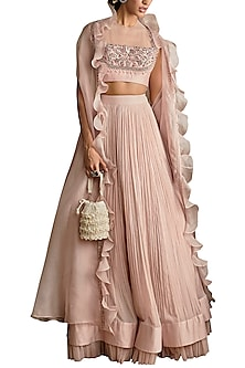 Pale Pink Ruched Lehenga Skirt With Hand Embroidered Blouse & Ruffled Cape by Ridhi Mehra