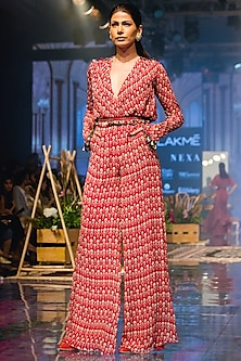 Red Printed Jumpsuit With Coin Belt by Ridhi Mehra