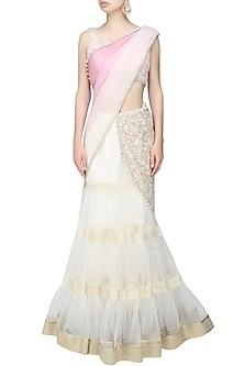 Ivory and pink fully embroidered net tier lehenga saree by Rabani & Rakha