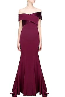 Oxblood off shoulder flared crossover gown by Rutu Neeva