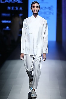 White Lycra Trousers by Rajesh Pratap Singh Men