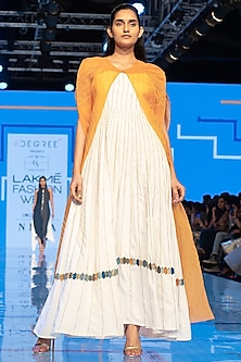 White Embroidered Gown With Yellow Cape by Rajni Suyach