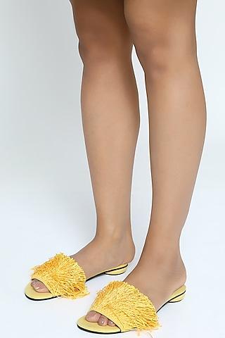 Yellow Sliders With Fringed Embellishments by Rimzim Dadu