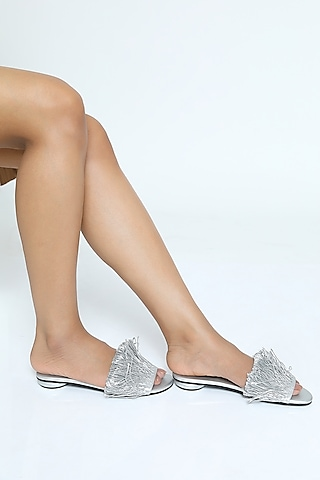 Silver Sliders With Fringed Embellishments by Rimzim Dadu