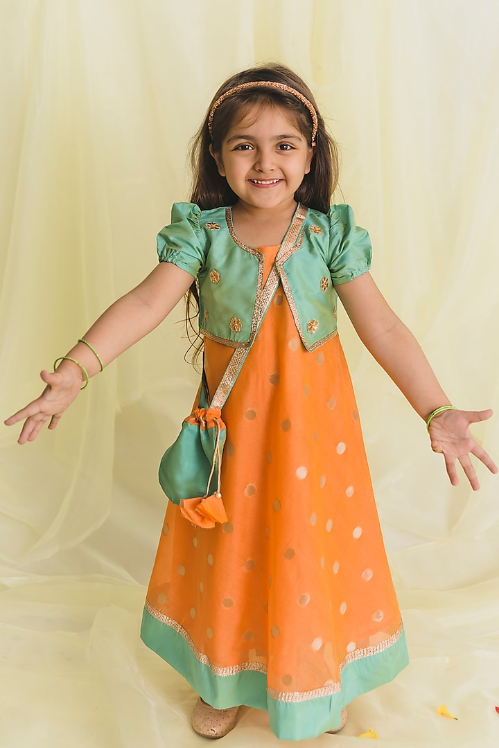 Rust Orange And Green Gown With Potli Bag by Saka Designs
