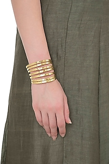 Gold Plated Textured Lines Hand Cuff by Flowerchild By Shaheen Abbas