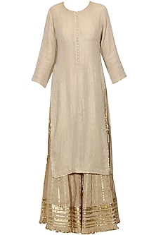 Beige and gold gota patti work kurta and sharara set by Sukriti & Aakriti
