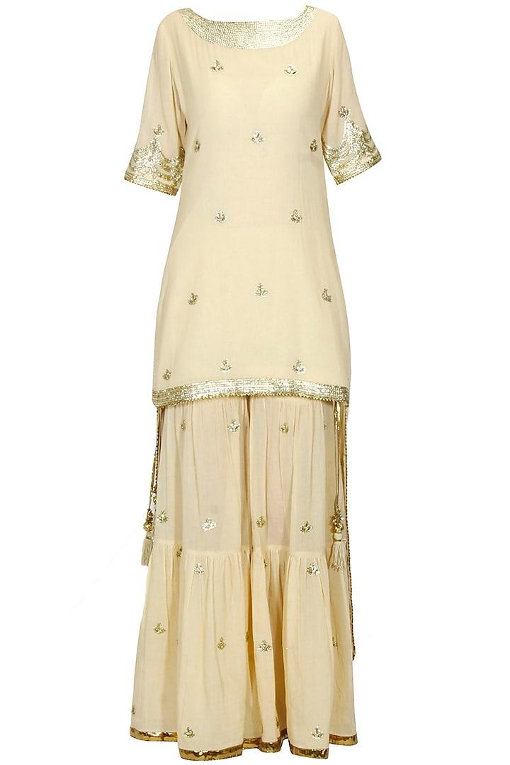 Beige sequins and gota patti work kurta and frilled sharara set by Sukriti & Aakriti