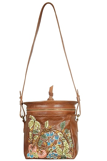 Brown silk thread and zari embroidered round leather bag by Samant Chauhan Accessories