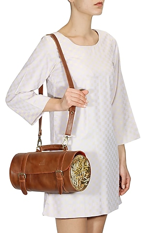 Brown silk thread and zari embroidered round cylindrical leather bag by Samant Chauhan Accessories