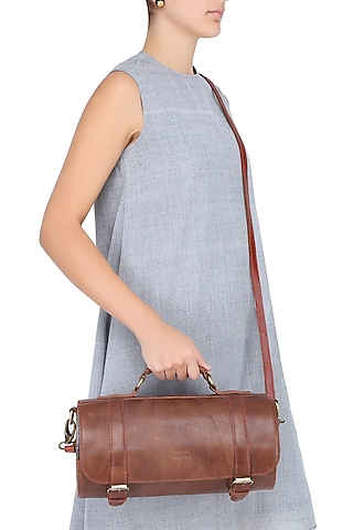 Brown Silk Thread and Zari Embroidered Cylindrical Leather Bag by Samant Chauhan Accessories