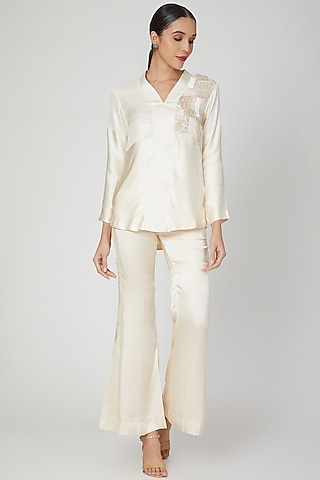 Cream Sequins Detailing Short Kurta With Pants by Siyona By Ankurita