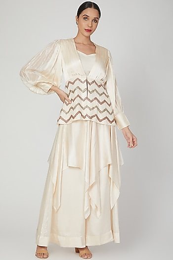 Cream Sequins Embroidered Peplum Top With Tube & Pants by Siyona By Ankurita