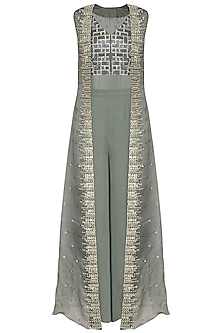 Green embroidered crop top with pants and cape by Sanya Gulati