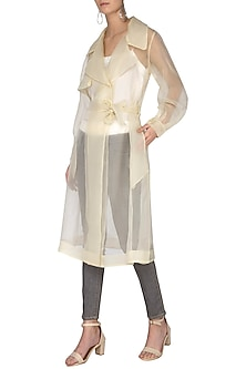 Lemon yellow sheer trench coat with bustier by Shilpi Gupta Surkhab