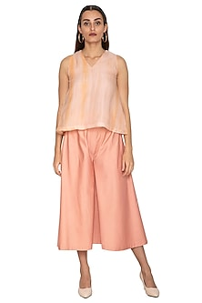 Peach Cotton Satin Flared Pants by Shiori