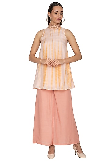 Peach Cotton Silk Flared Pants by Shiori