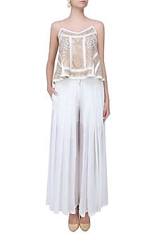 Nude And Ecru 3D Floral Motifs Camisole Top And Flared Pleated Pants Set by Shasha Gaba
