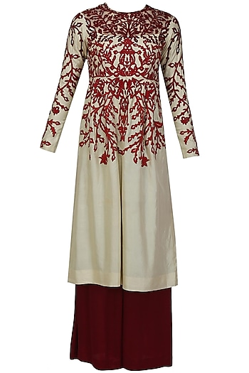 Cream and red floral thread embroidered kurta and maroon palazzo pants set by Shasha Gaba