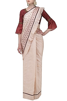 Beige Saree with Polka Dots and Red Embroidered Blouse by Shasha Gaba