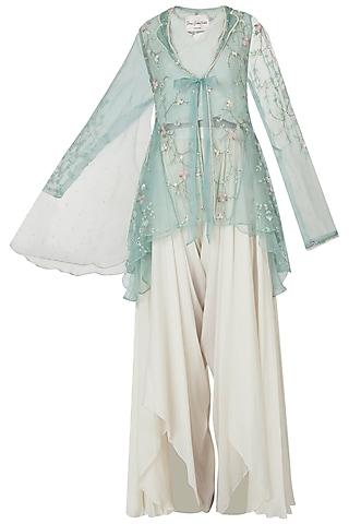 Emerald embellished jacket with ivory top and drape pants by Shreya Jalan Mehta