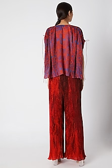 Red Micro Pleated Palazzo Pants by Saaksha & Kinni