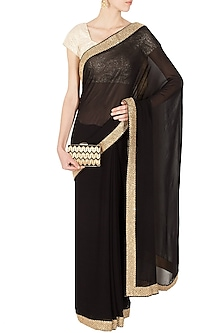 Black and gold embroidered sari by Sonal Kalra Ahuja