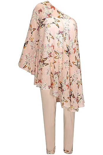 Blush pink off shoulder printed cape with pants by Sonal Kalra Ahuja