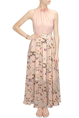 Blush pink printed maxi skirt with halter neck blouse by Sonal Kalra Ahuja