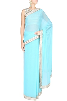 Light Blue Shimmer Saree With Sleeveless Sequinned Blouse by Sakshi Gupta
