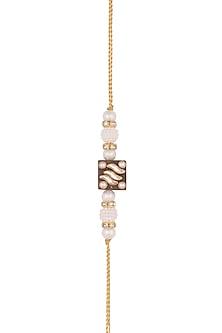 Gold Finish Kundan & Pearl Embellished Rakhi by SONNET