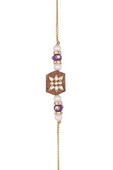 Gold Finish Pearl & Kundan Rakhi by SONNET