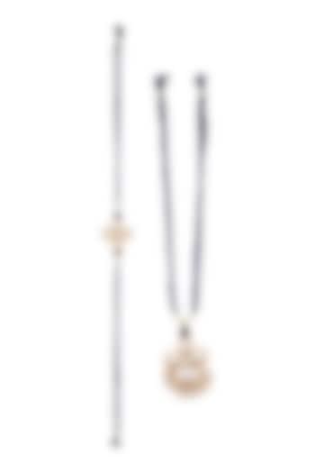 Gold Finish Kundan Rakhi & Pearl Lumba Set by SONNET